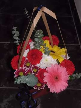 basket of flowers- roses and gerbera