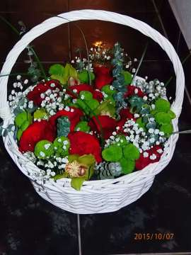 basket of flowers- roses chrysanthemum orchid