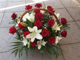 A basket of roses and lilies