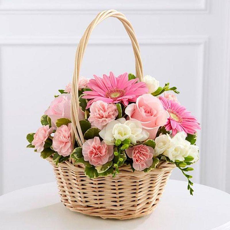 basket of flowers- roses chrysanthemum orchid